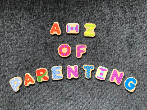 A - Z of parenting spelt out with childrens wooden puzzle pieces
